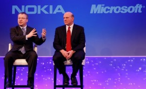 "Stephen Elop CEO of Nokia, left, with CEO of Microsoft Steve Ballmer, speaking in London, as he announces the strategic partnership with Microsoft, Friday, Feb. 11, 2011. Technology titans Nokia and Microsoft are combining forces to create smart phones that might challenge rivals like Apple and Google and revive their own fortunes in a market they have struggled to keep up with.Nokia Corp., the world's largest maker of mobile phones, said Friday it plans to use Microsoft Corp.'s Windows Phone software as the main platform for its smart phones in an effort to pull market share away from Apple's iPhone and Android, Google's software for phones and tablets. Nokia said it will help drive the future of Windows Phone ""innovating on top of the platform in areas such as imaging, where Nokia is a market leader.""(AP Photo/Alastair Grant)"